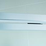 semi-frameless shower enclosure close up