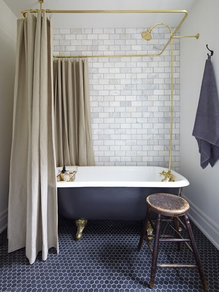 Black and white bathroom with gold shower