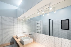 Amazing-bathroom-with-wood-cabinet-modern-sink-amazing-mirror-mazing-LED-lamps-and-white-ceramic-wall
