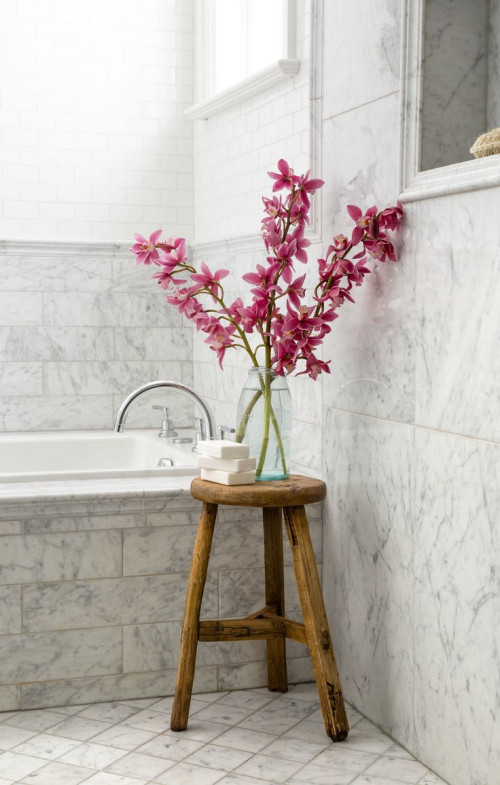 Flowers on top of wood stool in bathroom