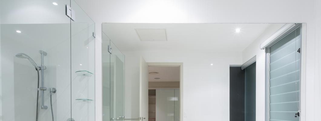 Australian bathroom with frameless shower and glass hardware